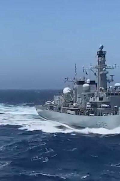 Moment RFA Fort Victoria Transfers Ammunition To HMS Richmond At Sea