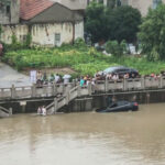 Locals Work Together To Rescue Chinese Driver Who Reversed In River
